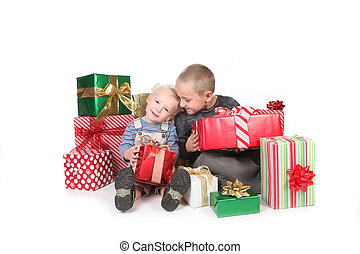 Happy Children Enjoying Christmas Gifts - Two Happy Children...