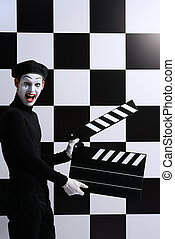 cinematography - Movie actor and a mime posing with clapper...