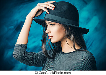 fedora - Profile portrait of a magnificent young woman in a...