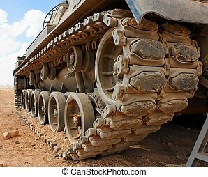 Tracks of the Israeli Magach tank in the desert closeup