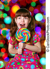 Bright and Colorful Happy Little Girl Licking a Lollipop
