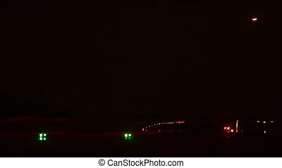 Night arrival - Airplane on final approach before landing at...