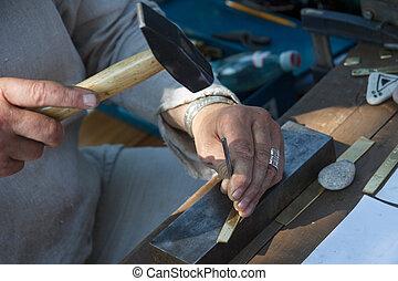 Craftsman - A craftsman using a hammer and a nail