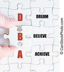 Last puzzle piece with Business Acronym DBA - Hand of a...