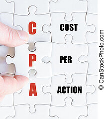 Last puzzle piece with Business Acronym CPA - Hand of a...