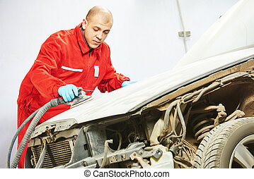 auto mechanic sanding and polishing car - auto mechanic...