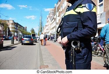 city security. policeman in the street - city security and...