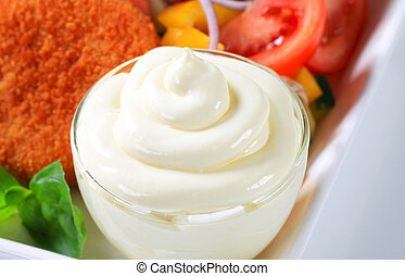Closeup of a mayonnaise swirl in a glass cup