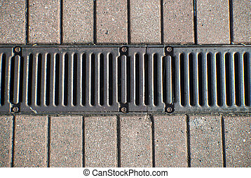 grill between brick pavers - grill or drain between 2 rows...