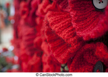 knitted red poppies on Anzac Day - close up of knitted red...