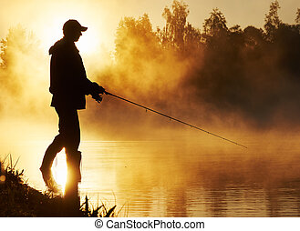fisher fishing on foggy sunrise - Fisher man fishing with...