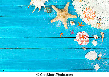 Summer accessories on blue wooden background studio shot