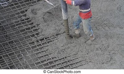 Workers working on construction site, a laborer pulling the...