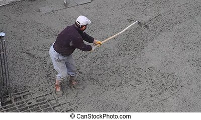 Concrete rake does a better job smoothing out chunky...