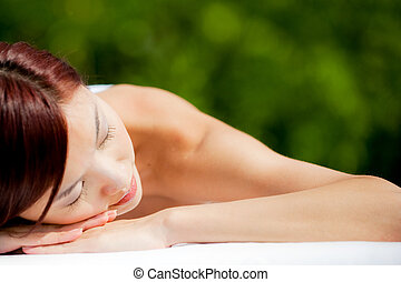 Woman Lying Down - A beautiful asian woman lying down on a...