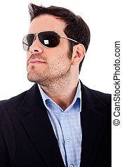 Closeup of a business man with sunglasses on a white...