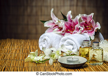 Aroma therapy - Towels, oil, candle, flowers for spa...