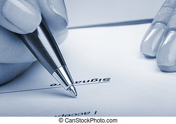 Reviewing contract - Closeup of young female signing...
