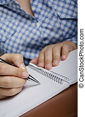 Noting - Businesswoman is writing her planning