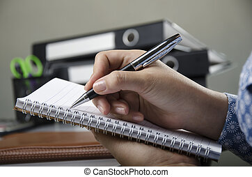 Noting detail - Office worker n