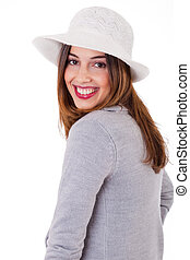 Young smiling face model wearing a coat and hat