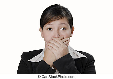 mouth shut - a businesswoman closed her mouth with her hands