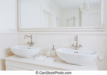 Designed washbasins in retro bathroom - Close-up of designed...