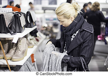 Beautiful woman shopping in clothing store - Woman shopping...