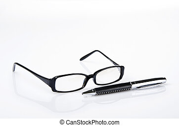 Black ballpoint pen and glasses