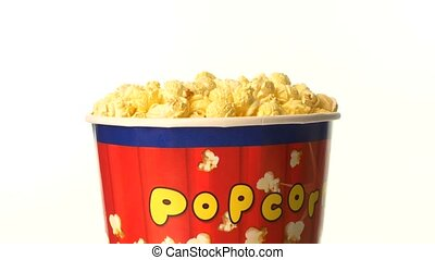 Popcorn in box on white, rotation - Top of popcorn in box on...