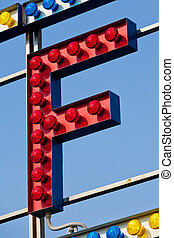 F letter circus neon sign