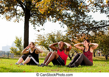 Park Exercise - A group of people doing exercises in the...