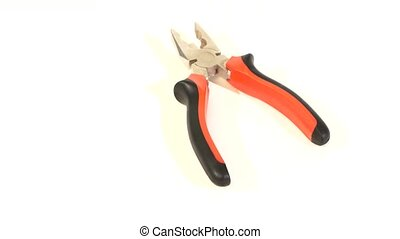 Gray and red pliers on white, rotation - Open gray and red...