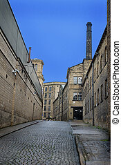 Old cobbled street with textile mills