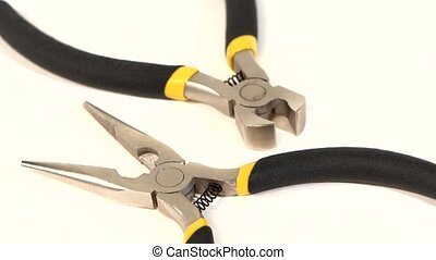 Wire cutters and mini cutters on white, rotation, close up -...