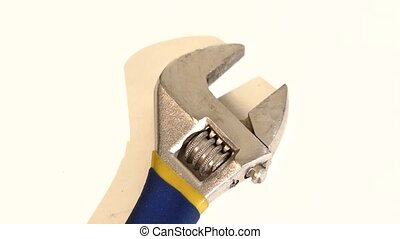 Adjustable wrench on white, rotation, close up - Blue and...