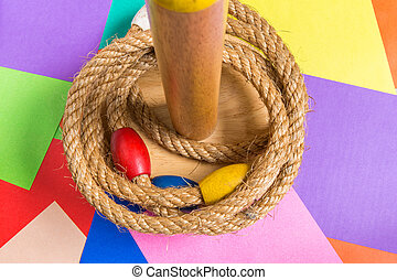 Ring Toss Game on Wood Background - Ring toss game is a...