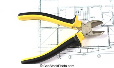 Cutting pliers on building plan, scheme, rotation - Open...