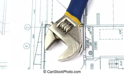 Adjustable wrench on building plan, scheme, rotation, close...
