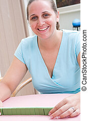 young lady playing games - a smiling young lady playing a...