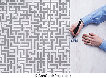 Business challenge concept - Businessman entering a maze and...