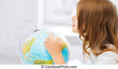 curious student girl with globe at school - education and...