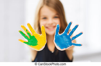 girl showing painted hands - education, school, art and...
