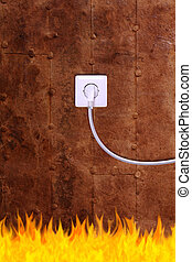 rusty iron wall with an electrical outlet and fire