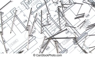 Metal nails on building plan, rotation - Many metal nails...