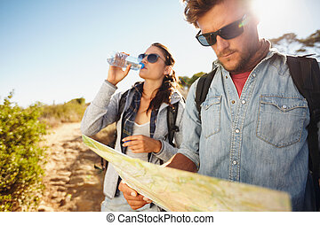 Couple on country walk together, summer vacation in...