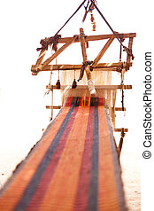 Traditional loom and homespun fabric in a Bedouin village,...