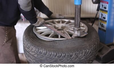 Mechanic repair wheel - Mechanic in the service repair car...