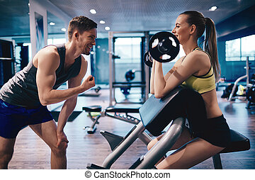 Weightlifting with trainer