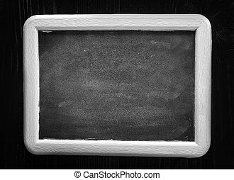 black board and white chalk on a table